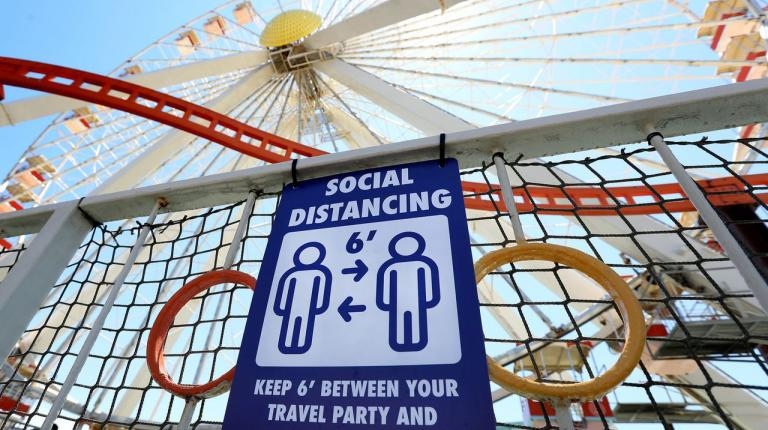 Signage instructs guests to maintain social distancing while visiting Mariner's Amusement Pier as Morey's Piers in Wildwood prepares to fully reopen
